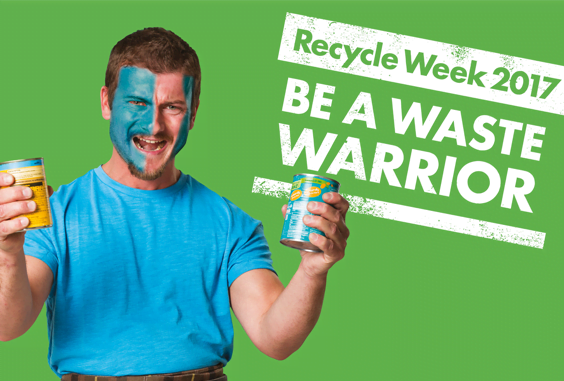 Man holding tins to demonstrate power of recycling