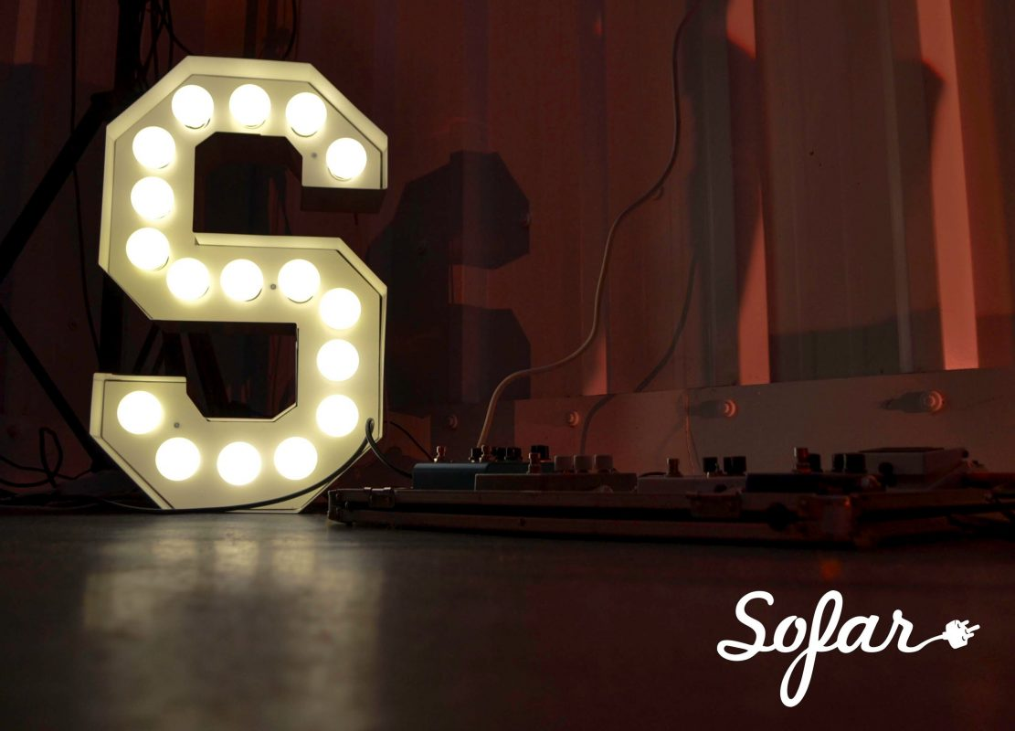 Large lit-up S in the background with Sofar logo at the front