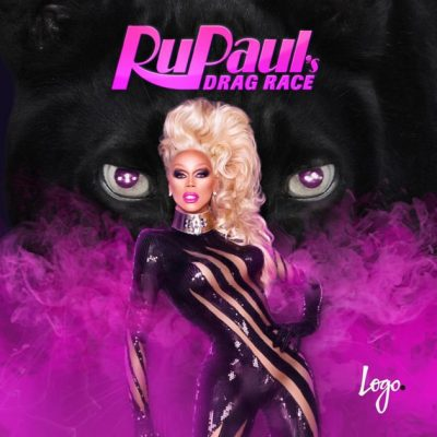 Drag Queen Rupaul stands in a black, glossy bodysuit in front of two large, glaring eyes veiled behind pink smoke