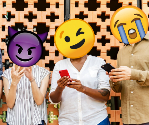 Emojis superimposed on people's heads who are standing on their phones. From left to right: wink emoji, purple devil emoji, cry emoji.