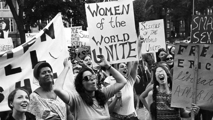 Women protest with pickets during feminist movement